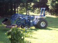 Ford 1300 Tractor, liquid filled turf tires, rear wheel