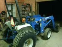 FORD 1620 DIESEL 4X4 TRACTOR WITH LOADER. TRACTOR HAS