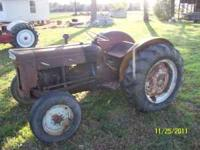 This is a rare Ford 2000 Diesel tractor, it was sold in