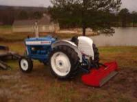 3000 Ford Diesel Tractor with New Paint, good back