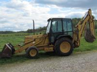 FORD 555D BACKHOE, EXTEND HOE, CAB, HEAT, NEW TIRES,