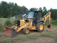 good running backhoe, 2wd, G.P Bucket,, has sims rops,