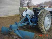 FORDS 600 TRACTOR WITH HEAVY DUTY FORD GRADER BLADE, 12