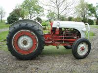 Family owned 4 wheel general purpose tractor. Resleeved