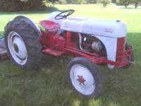 Ford 8n with 5ft.bush-hog.Good runing tractor.call