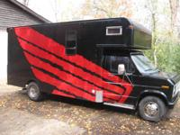 This is a 1989 Ford E-350 cube van built for motocross
