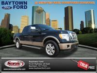 This 2011 Ford F-150 Lariat has it all! She's barely
