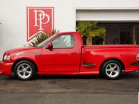 2003 Ford F-150 Lightning in Bright Red with Medium