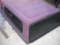 A nice Maroon Fiberglass Topper that may also fit other