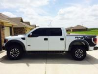 I have a 2014 White ford raptor for sale. This thing is