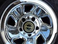An extremely nice chromed oem ralley 15 inch wheel with