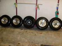 "I have for sale a set of 15"" Ford Factory Wheels with a"