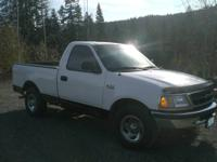 1998 Ford F150 pickup truck with 6-cylinder, 5spd