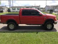 Red Ford f150 2001 xlt 4x4 supercrew 5.4 LV8 lifted. In