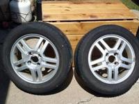 "Two 15"" Ford Focus wheels with tires. Good condition."
