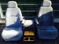Custom-made front bucket seats with center storage