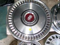 1)-- I HAVE A SET OF 4 15 INCH LTD HUBCAPS.--$25.00.