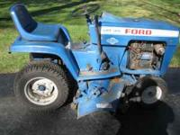 "Ford riding tractor LGT 125 ,14 h.p. with 42"" mower"