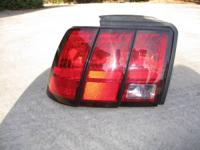 It works! Has small crack in it. Driver side tail light