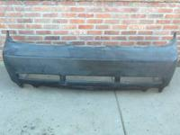 A used Saleen style replica rear bumper cover for a