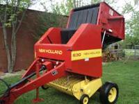 This is a New Holland 630 round Baler. This baler is in
