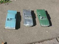 Three Ford cars from the 1960s.... first is a Silver