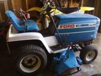 For Sale: Ford Riding Lawn Mower....Has a 12 horse
