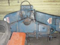 FORD DECK FOR A FORD RIDING LAWN MOWER IN GOOD SHAPE