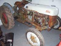 early ford tractor 3 speed tractor , front tires are