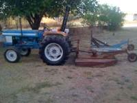 1985 Ford Tractor and (2) 4 row shredders for sale.