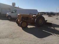 1962 Ford Tractor with 6 ft blade for scraping. Has