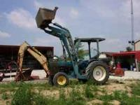 Ford tractor with heavy duty loader, tractor has 3