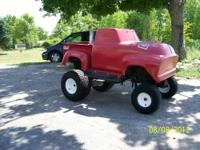I am selling a nice unique custom tractor/cart built on