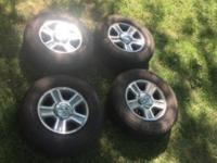 I have four factory wheels and tires off of a 2005 Ford