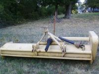 This listing is for a Ford Flail Mower. The mower has a