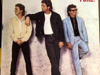 This is a vinyl LP of the album Fore! by Huey Lewis and