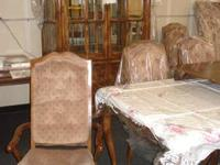 -China Cabinet is lighted with beveled glass. Table