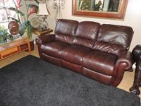 Here is a Beautiful Formal Single Reclining Cognac