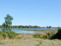 Beautiful lakefront acreage with home on Lake Buffum, a