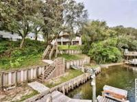 GORGEOUS, SECLUDED, CUSTOM BUILT, DEEP WATER BAYOU