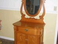 This is a hutch with mirror and a single drawer and