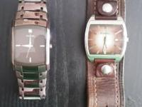 Two excellent condition watches. Metal one comes with