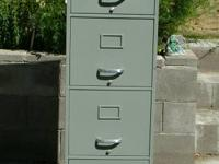 "Four Drawer File Cabinet  Heavy Metal 52""H x 15"" W x28"