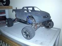 Two traxxas and a tamiya and duratrax .the stampede is