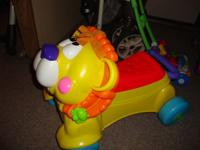 Fisher Price Lion Ride on and converts to a push