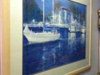 This is a great framed picture of boats in the harbor.
