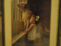 Beautiful framed print of dog and young girl. In