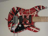 This is a nice finished project guitar, handpainted by
