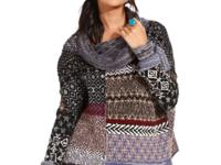 With mixed patterns, this Free People sweater is