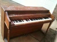 Free Piano. About 36 inches tall. Two of the keys have